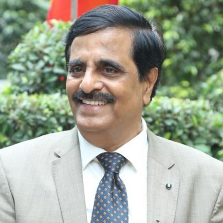Dr. Manu Baligar